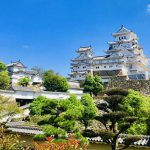 This is a photo of Himeji Castle in Himeji City, Hyogo, Japan. In the center, the large and small castle towers are connected by turrets. Not only the castle towers, but all the other buildings, gates, and stone walls are well preserved.