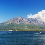 This is Sakurajima, an active volcano in Kagoshima at the southern tip of Kyushu in Japan. Surrounded by Kagoshima Bay, the volcanic smoke rising from the summit of Sakurajima is a magnificent sight.