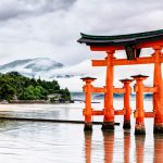 It is Itsukushima Shrine in Hiroshima, Japan, known for its floating shrine above the sea. In the photo, the vermilion torii gate is in the sea.