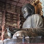 This is a photo of the Great Buddha in Todaiji Temple in Nara, Japan. The Great Buddha is made of copper and others, and the height of the statue is 18 meters high. The Great Buddha Hall is one of the largest wooden structures in the world at 57.5 meters high.