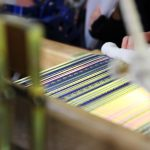 This photo shows Hakata-ori, the traditional craft of Fukuoka, being woven with colorful silk threads. This image is also linked to the Live Online Traditional Crafts Tours page.