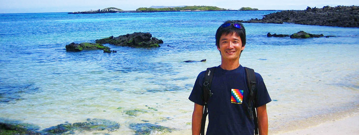 Makoto Tanaka, president of Trip Insight Corp. smiles as he stands on a beach on Albemarle Island (Isla Isabela) in the Galapagos Islands, Ecuador. The sea is crystal clear and very beautiful.